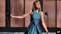 Taylor Swift presents the award for best new artist at the 57th annual Grammy Awards on Feb. 8, 2015, in Los Angeles.