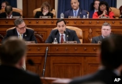 FILE - House Intelligence Committee member Rep. Joaquin Castro, D-Texas (center) flanked by Rep. Denny Heck, D-Wash. (left) and Rep. Rick Crawford, R-Ark., at a hearing on Capitol Hill in Washington, March 20, 2017.