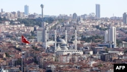 A view taken on Aug. 9, 2019 from Ankara Castle shows Kocatepe Mosque and Atakule television tower, top second from left, in Ankara, Turkey.