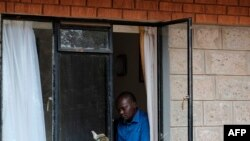 A man reads a book to pass the time at a government designated quarantine facility in Nairobi on April 4, 2020.