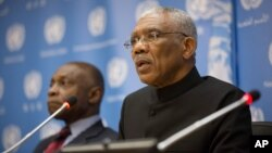 FILE -Guyana's President David A. Granger, right, with Guyana's Vice President and Foreign Minister Carl Greenidge, delivers remarks during a press briefing at the United Nations headquarters in New York, Sept. 29, 2015.