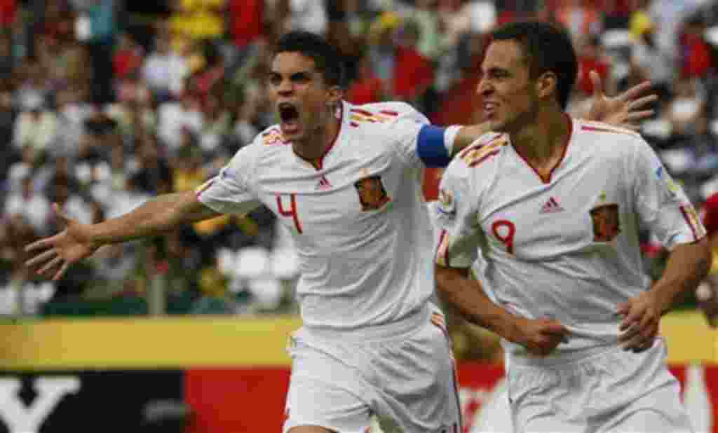Spain's Marc Bartra, left, celebrates after teammate Rodrigo, right, scored against Costa Rica during a U-20 World Cup group C soccer match in Manizales, Colombia, Sunday, July 31, 2011. (AP Photo/Nestor Silva)