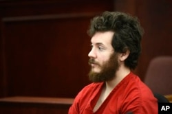 FILE - James Holmes in the courtroom in Centennial, Colorado, March 27, 2013.