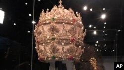 A jewel-encrusted papal tiara from the Sistine Chapel sacristy at the Vatican is displayed at the Metropolitan Museum of Art, May 7, 2018.