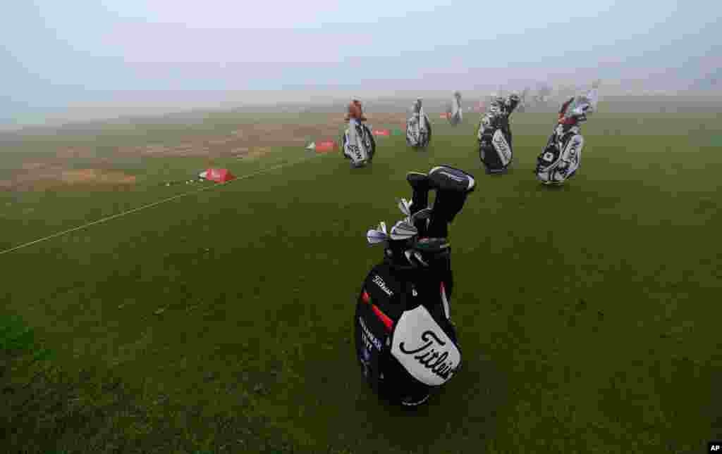 Players' bags sit abandoned on the practice range as fog delayed the start of the second round of the Abu Dhabi HSBC Golf Championship in Abu Dhabi, United Arab Emirates.