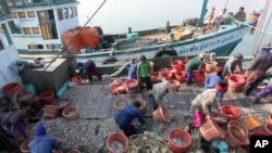 Myanmar workers work on fishing boats at a pier in Prachuabkhirikhant province, southern Thailand, file photo.
