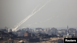 Trails of smoke are seen after the launch of rockets from the northern Gaza strip towards Israel (file photo).
