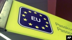 FILE - An EU sign greets international travelers at a passport control checkpoint at Tegel Airport, in Berlin, Germany, Feb. 28, 2001.