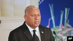 FILE - Fiji's leader Frank Bainimarama comments on how the country's constitution enshrines principles including an independent judiciary, a secular state, and a range of civil, political, and socio-economic rights, during a speech in Suva, Sept. 6, 2013.