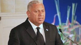 FILE- Fiji's Prime Minister Frank Bainimarama comments on how the country's constitution enshrines principles including an independent judiciary, a secular state, and a range of civil, political, and socio-economic rights, during a speech in Suva, Sept. 6, 2013.