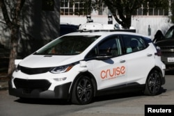 FILE - A self-driving GM Bolt EV is seen during a media event where Cruise, GM's autonomous car unit, showed off its self-driving cars in San Francisco, California, Nov. 28, 2017.