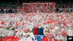 FILE - Floral tributes are seen at Hillsborough Stadium in Sheffield, England, on April 17, 1989, after an April 15 human crush at an overcrowded soccer match at the stadium killed 96 people.