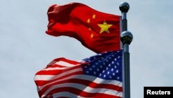 """Ý tưởng dỡ bỏ thuế quan không phải là một phần của thỏa thuận """"bắt tay"""" ban đầu được khởi sự từ tháng 10 giữa Phó Thủ tướng Trung Quốc Lưu Hạc và Tổng thống Hoa Kỳ Donald Trump."""