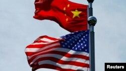 Zastave Kine i SAD pred razgovore o trgovini u Šangaju