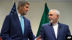 FILE - U.S. Secretary of State John Kerry, left, meets with Iranian Foreign Minister Mohammad Javad Zarif at United Nations headquarters, Sept. 26, 2015.