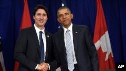 美國奧巴馬總統與加拿大總理賈斯汀特魯多資料照。