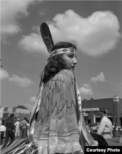 Eula Mae Narcomey Doonkeen (Seminole) in the American Indian Exposition Parade. Andarko, Oklahoma, ca. 1952. 45EXCW6. © 2014 Estate of Horace Poolaw. Reprinted with permission.