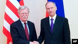 U.S. National Security Adviser John Bolton, left, and Russian Security Council chairman Nikolai Patrushev pose for a photo prior their official talks in Moscow, Russia, Oct. 22, 2018.