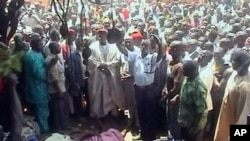 In this image taken from TV showing the bodies of victims of inter-faith violence as a crowd gathers around, in the town of Dogo Nahawa, Nigeria, south of the city of Jos (File Photo)