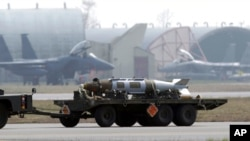 FILE - A weapon is carried by a truck at the Aviano NATO air base, in Aviano, Italy, March 25, 2011. A set of 80 cards on an online flashcard site detailed hot and cold vaults at the air base, according to a report May 28, 2021.