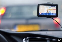A TomTom navigation device is seen in this photo illustration taken in Amsterdam, February 28, 2012.