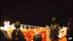 Picture from the Royal Malaysian Navy shows Somali pirates detained by Malaysian naval commandos following a firefight to free a hijacked oil tanker in the Gulf of Aden, 21 Jan 2011