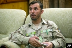 FILE - Gen. Abdul Raziq, Kandahar police chief, speaks during an interview with The Associated Press in Kandahar, Afghanistan Aug. 4, 2016.