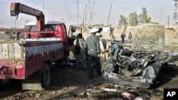 ئۆتۆمبیلی حاجی عهبدول جهبار فهرمانڕهوای ناوچهی ئهرغهندهبی که تیایدا خۆی و کوڕهکهی و پاسهوانێـکی کوژران، قهندههار، سێشهممه 15 ی شهشی 2010