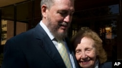 FILE - Fidel Castro Diaz-Balart, son of Cuba's former President Fidel Castro and senior researcher and professor of the Cuban Academy of Sciences meets his mother, Mirta Diaz-Balart, during the opening session of a scientific seminar in Havana, Nov. 14, 2008.