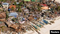 Aerial view of damaged coastal houses in wake of Typhoon Haiyan, Iloilo Province, central Philippines, Nov. 9, 2013.