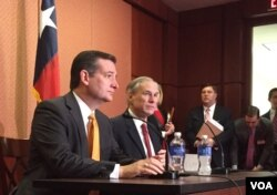 FILE - Republican presidential candidate Sen. Ted Cruz, R-Texas, left, and Texas Gov. Greg Abbott, speak about the resettlement of Syrian refugees in the U.S., during their joint news conference on Capitol Hill in Washington, Dec. 8, 2015 (VOA/ M. Bowman).