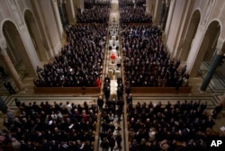 FILE - The procession for the funeral mass for the late Supreme Court Associate Justice Antonin Scalia at the Basilica of the National Shrine of the Immaculate Conception in Washington, Feb. 20, 2016.