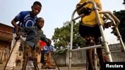 Boys with polio undergo therapy at the International Polio Victim Response Committe (IPVRC) compound in Democratic Republic of Congo's capital Kinshasa.