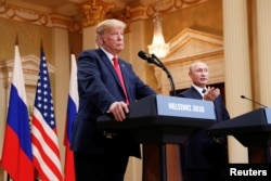 Russia's President Vladimir Putin gestures during a joint news conference with U.S. President Donald Trump after their meeting in Helsinki, Finland, July 16, 2018.