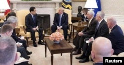 South Korea's national security chief, Chung Eui-yong, briefs U.S. President Donald Trump at the Oval Office about his visit to North Korea, March 8, 2018.