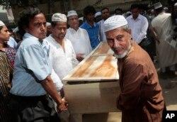 FILE - Bangladeshi Muslims carry the body of Xulhaz Mannan for his funeral in Dhaka, Bangladesh, April 26, 2016.