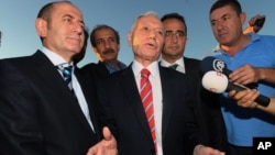 Mehmet Haberal, center, a surgeon and founder of an Ankara university, is accused of being part of an alleged ultra-nationalist and pro-secular gang called Ergenekon, Aug. 5, 2013.
