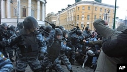 Football fans clash with riot police in central Moscow after Yegor Sviridov, 28, a dedicated fan of the Spartak Moscow football team was shot dead earlier this month, Dec 11, 2010