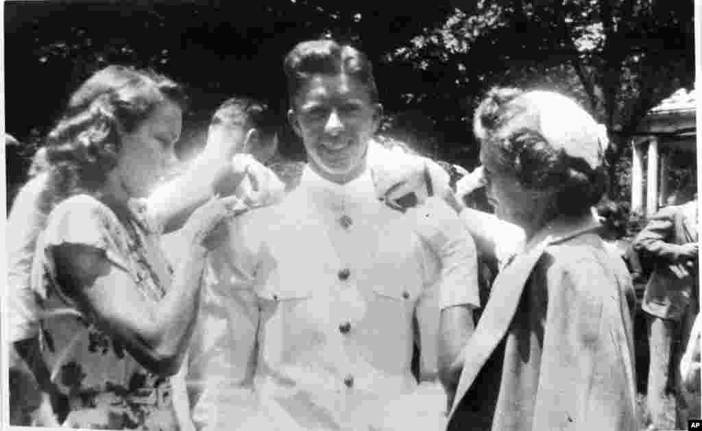 In this undated file photo, Jimmy Carter gets his bar pinned by his wife Rosalynn, left, and his mother Lillian Carter at the U.S. Naval Academy.