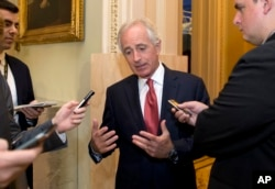 """FILE - Senate Foreign Relations Committee Chairman Bob Corker, R-Tenn., talks with reporters on Capitol Hill in Washington, Oct. 20, 2015. Corker said Thursday that he looked forward """"to continuing our work to hold Tehran accountable."""""""
