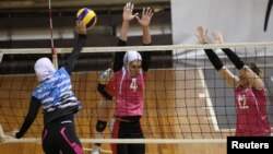 "Iranian volleyball players Maedeh Borhani (C) and Zeinab Giveh (L) take part in a training session of ""Shumen"" volleyball club in Shumen, Bulgaria, Jan. 14, 2017."