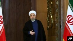 FILE - Iran's President Hassan Rouhani arrives for an address to the nation after a nuclear agreement was announced in Vienna, in Tehran, Iran, July 14, 2015.
