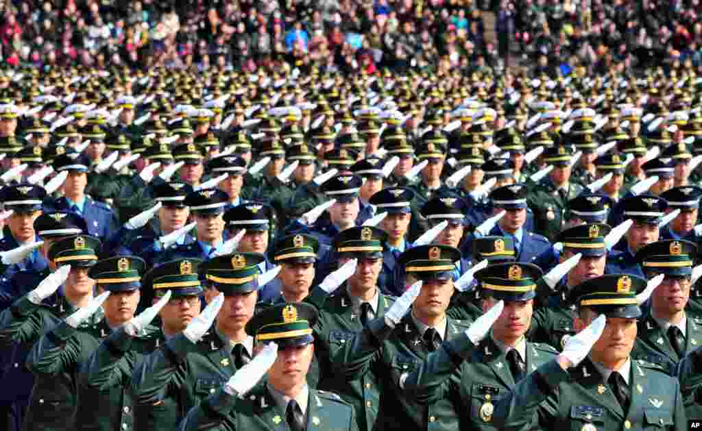 New South Korean military officers salute during the joint commission ceremony of over 5,000 new military officers of the Army, Navy, Air Force and Marines at the military headquarters in Gyeryong, south of Seoul.