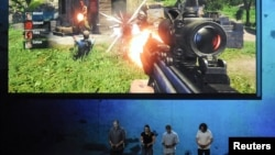"Ubisoft staff demonstrate the ""Far Cry 3"" video game in Los Angeles, California, June 4, 2012."