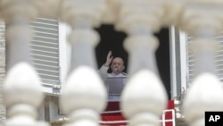 FILE - In this Sunday, June 7, 2020 file photo, Pope Francis delivers his blessing as he recites the Angelus noon prayer from the window of his studio overlooking St.Peter's Square, at the Vatican. (AP Photo/Andrew Medichini, File)