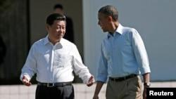 Presiden AS Barack Obama dan Presiden China Xi Jinping di rumah peristirahatan kepresidenan di Sunnylands, Rancho Mirage, California (8/6).
