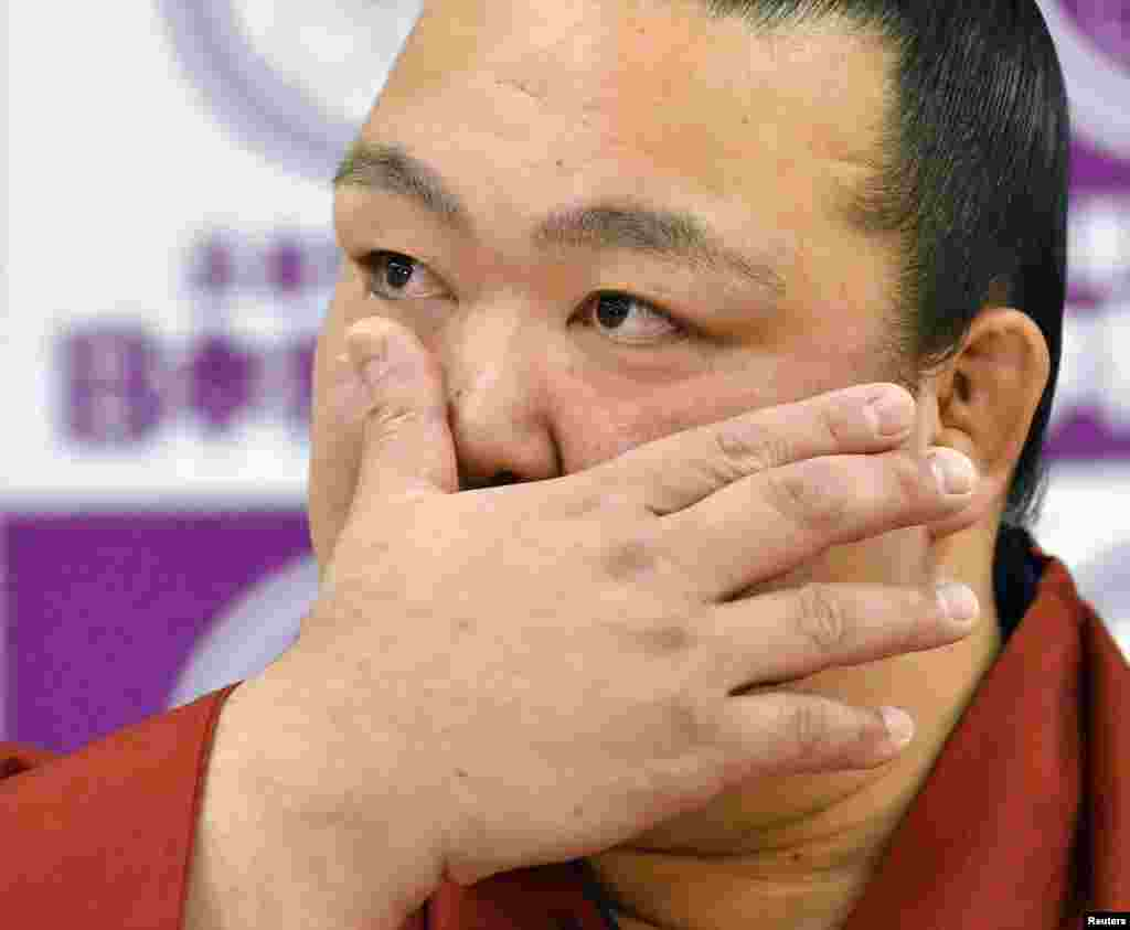 Sumo grand champion Kisenosato wipes his tears as he attends his retirement news conference in Tokyo, Japan, in this photo by Kyodo News.