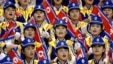 FILE - North Korean women cheer their men's basketball team during a game against the Philippines at the 14th Asian Games in Pusan, South Korea.