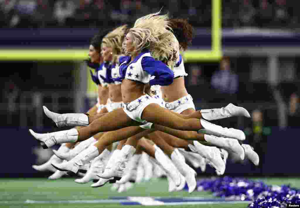 Dallas Cowboys cheerleaders jump as they perform prior to the game against the New Orleans Saints at AT&T Stadium, Arlington, TX, USA, Nov 29, 2018. (Matthew Emmons-USA TODAY Sports)