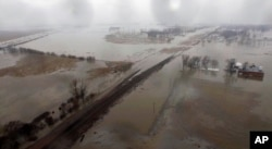 FILE - This aerial photo shows flooding along the Missouri River in Pacific Junction, Iowa, March 19, 2019.